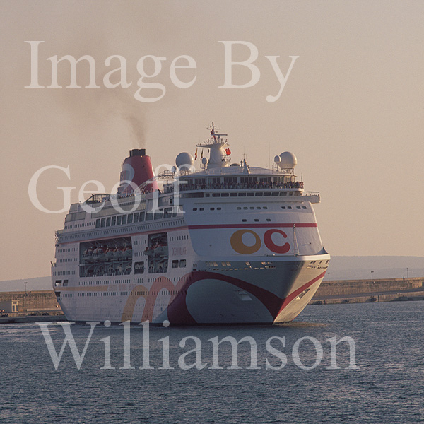 GW12435-50 = Pre sunset departure of P and O Cruise ship Ocean Village