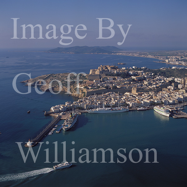 GW02470-50 = Aerial view over Ibiza Town and port with Formentera