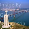 GW02980 = Aerial view of 100m high Statue of Christ the King looking towards Ponte 25 de Abril (1966 built bridge), River Targus and Belem district of Lisbon, Portugal. Sep 1997.