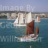 GW06590 = Tomi (No.48) + Thopago (No.6) sailing out to join the Conde de Barcelona Classic Boats Regatta (Paseo Maritimo and Belver Castle behind), Palma de Mallorca, Baleares, Spain. 26 Aug 2000.