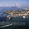 GW02470 = Aerial view over Ibiza Town and port with Formentera ferry + Windstar Sailing Cruise liner, Ibiza, Baleares, Spain. 28 Sep 1996.