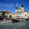 GW01700 = Church of St. Nicholas in the old town with carriage. Prague, Czech Repulic. Aug 1995.